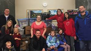 mayo clinic heart families who support the toy drive include the waletzkos left and rippys center as well as kari and rob ulrich right and their