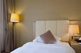 Standard bed in bedroom setting.