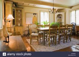 Antique wooden table chairs in dining room inside old reconstructed