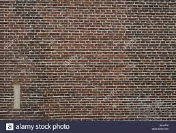 Abstract photograph of traditional textured red brick wall in fine ...