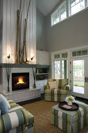 fireplace with raised hearth living room contemporary with beachy modern wall decals
