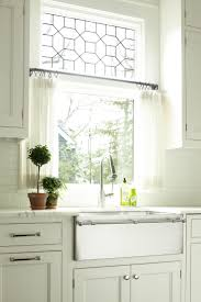 cafe curtains for kitchen white marble countertops and a fabulous farm sink with towel rack