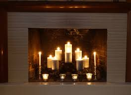 mesmerizing white candles in fireplace with grey subway brick added wooden mantels top in formal living room decors