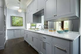 grey cabinets in kitchen. example of a mid-sized classic single-wall dark wood floor and brown grey cabinets in kitchen