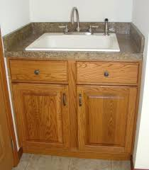 expand utility sink with countertop base cabinet