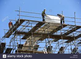 Scaffold Builders Builders High Up Working On Scaffold Stock Photo 60605416