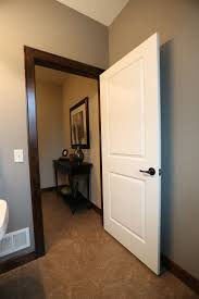 white interior doors with wood trim.  White Interior Doors  2 Panel White Molded Door With Dark Casing And Base Trim  Bayer Built Woodworks With White Wood Trim