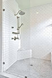 subway tile shower oversized shower with glass shower partition alongside dual shower heads framed by a