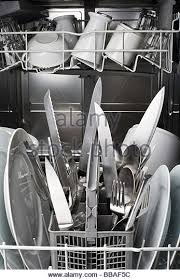 dishwasher clipart black and white. a dishwasher with knives sticking dangerously point side up - stock image clipart black and white