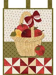 This rich and delightful laser-cut quilt features a big basket of ... & Quilted wall hangings Adamdwight.com