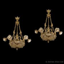 a fine pair of gilt bronze and crystal six light basket chandeliers