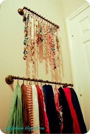 Hang two towel bars in your closet with S hooks for necklaces and