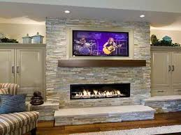 shelving ideas beside stone fireplace with tv above google search