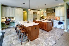 home office in kitchen. This Remodeled Kitchen Features Two Islands, A Home Office, Beverage Area And New Office In