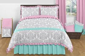 image of pink and turquoise bedding sets