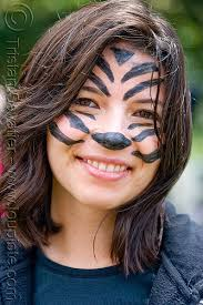 cute tiger face paint portrait woman bay to breakers costume