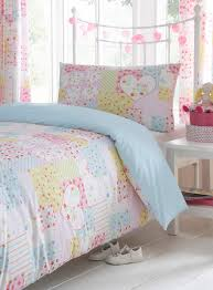 colorful girls bedroom decoration with soft pastels colors comforter and heart patchwork single bedding set