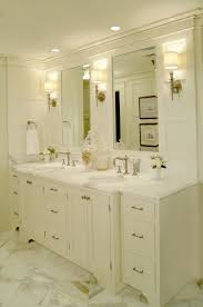 layered lighting. Master Bathroom Double Sink Vanity With Marble Floor Tile And Counter Top. White Painted Wood Layered Lighting