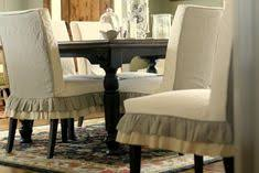 love these ruffle slipcovers for parson chairs