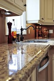 what is the best way to clean hard water stains from my granite counter tops especially around the sink and then keep the granite clean and shiny