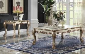 dresden coffee table in gold tone patina by acme w options