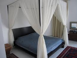 Image of: Headboards Low Profile Master Beds With White Canopy Bed Curtains