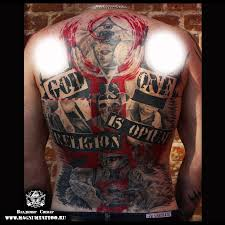 татуировки бог один в стиле трешполька спина лопатки каталог тату