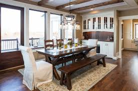 minneapolis pottery barn seagrass rugs dining room traditional with dark wood bench d chandeliers
