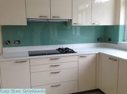 White Kitchen Uk Mint Green Coloured Glass Splashback In A White Kitchen With White