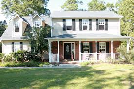 red front door on brick house. Matching Exterior Paint Colors With Brick Shutter For Red Ranch Dark Grey Siding Front Door House On E