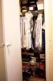 an unorganized closet stuffed with dress shirts and shoe boxes