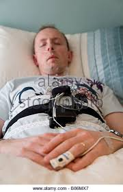 a man sleeping during an overnight home based sleep study wearing b86mx7