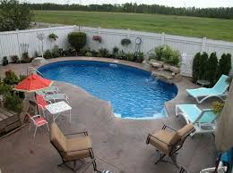 Small kidney shaped inground pool designs for small backyard with outdoor  furniture