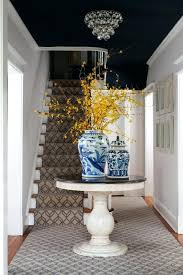 round foyer entry tables a round foyer table topped with pottery and a gorgeous yellow flowers round foyer entry tables
