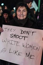 white privilege a protester holds a sign reading they don t shoot white women like me at a blacklivesmatter protest in the wake of the non indictment of a new york city