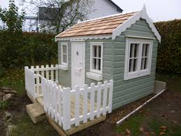 childrens playhouse with decked playarea wooden garden playhouse