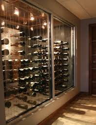 Hallway view of glass enclosed Cable Wine System custom wine cellar.