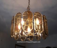 autumn garlands on a brass and glass chandelier