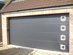 hormann lpu40 ribbed steel sectional garage door in anthracite grey with windows