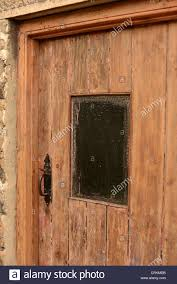 an old door with window stripped of paint and in need of restoration