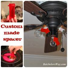 after a test fit we spray painted the pill bottle spacer to match the finish on our ceiling fan