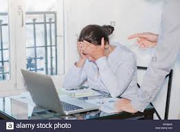 bad boss stock photos bad boss stock images alamy angry boss and stressed employee in the office punishment stock image