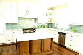 antique white subway tile love the ornamental granite cabinets with whit