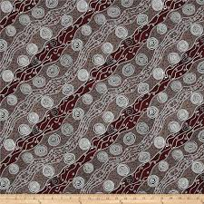 australia bush camp red from fabricdotcom designed by audrey martin napanarigka for m s textiles this cotton print fabric features an abstract design