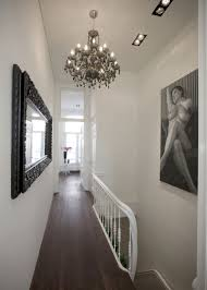 interior: Fabulous Hallway Designs With Beautiful Chandelier Closed Nice  Downlight Above Wood Floor Plus Human