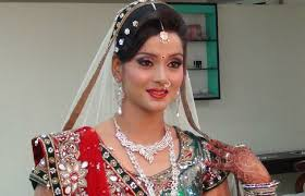 indian bridal makeup and hairstyle off white gold green