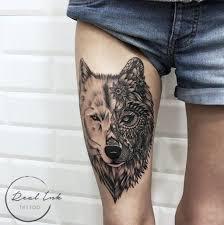 фото тату на ноге волка