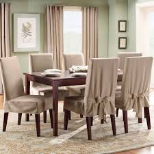 stunning creamy slip cover for dining room chairs design with wooden legs and wooden dining table
