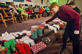 calvary baptist academy student william langer 13 places a gift on the altar to