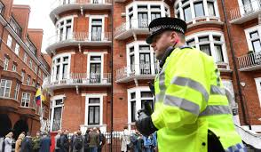 wikileaks office. A Policeman Walks Past Members Of The Media On May 19, 2017, Outside Embassy Ecuador In London, Where WikiLeaks Founder Julian Assange Has Lived Wikileaks Office